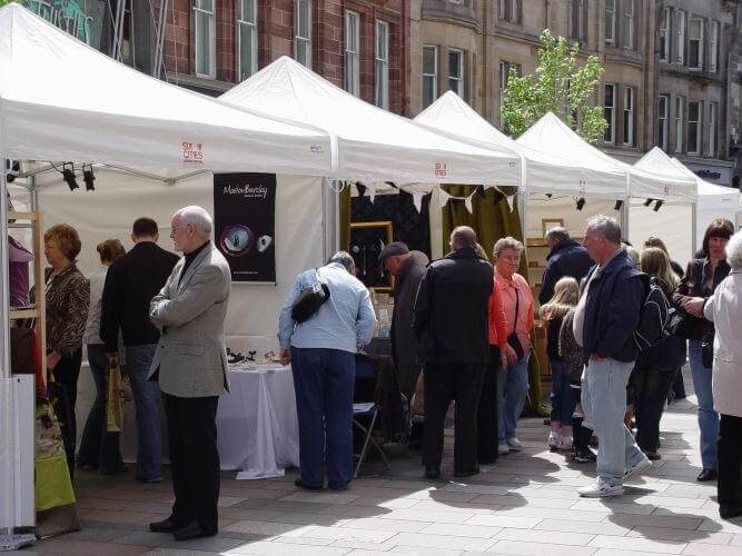 Small marquees and gazebos in a market stall setup